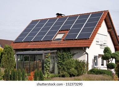 rural residence with solar panels on a roof