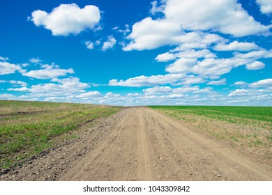 rural road against the sky with clouds