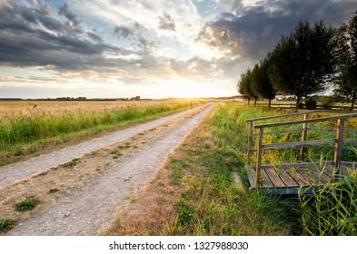 rural road and bridge in sunset sunshine
