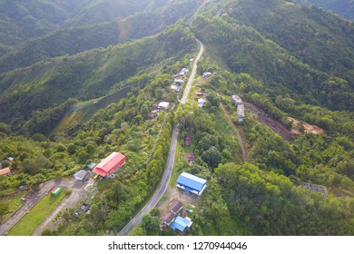 Rural road bulit on top of hill ridges in Sabah Malaysian Borneo.
