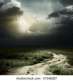 Rural road and dark storm clouds