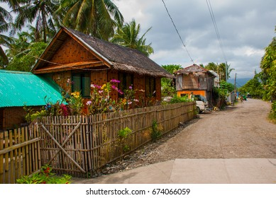 Rural road with houses in the Philippines. Pandan, Panay island