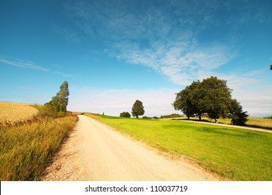 Rural road in latvian landscape.