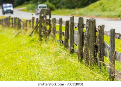 Rural road with an Old Wooden fence