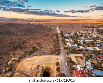 Rural road passing through Hawker - town in South Australia at sunset