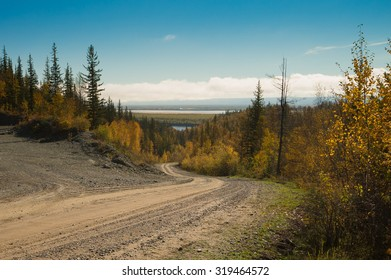 Rural road in siberian taiga, Sakha, Russia