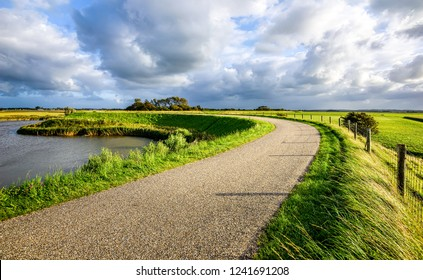 Rural road sky clouds landscape. Country rural road view. Rural country road. Rural summer road scene