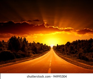 Rural road. A sunset.