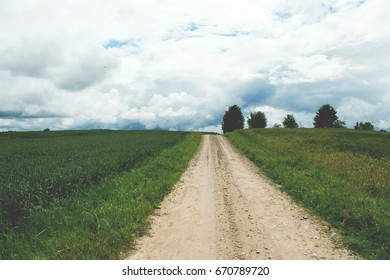 Rural Road. Rural road through agricultural fields during a daytime. Retro and vintage look