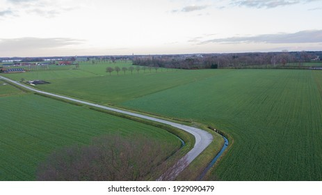 Rural Road Through Countryside. Rows of Farmfields. Summer Landscape. Aerial Drone View. High quality photo