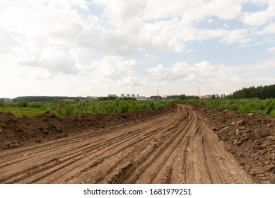 Rural road through a field. The builders laid a temporary road.