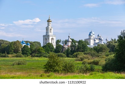 Rural Russian landscape with Orthodox Churches under blue cloudy sky in summer day. Veliky Novgorod, Russia