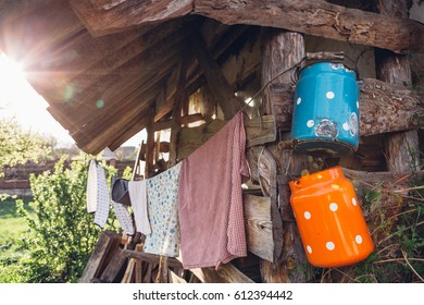 Rural scene with vintage milk cans and clothes on a rope