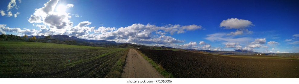 rural scene with wonderful blue sky and beautiful clouds in basilicata southern italy