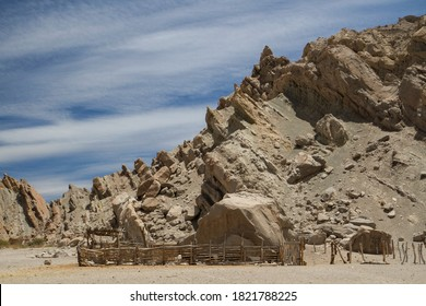 Rural scenic. View of the ranch rustic pen and fence in the arid desert. The sandstone and rocky hills in the background.