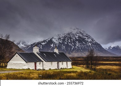 Rural setting in Glencoe  with Blackrock Cottage in front of Buachaille Etive Mor, Scotland, UK