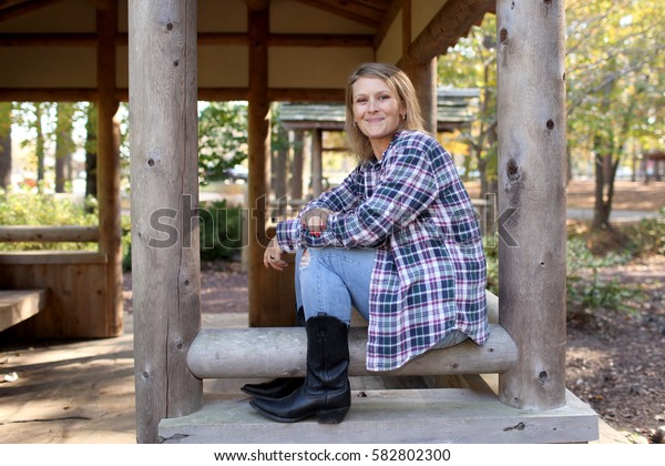 Rural setting and a middle aged woman