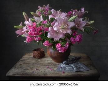 Rural still life with splendid bouquet of summer flowers