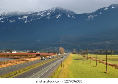 A rural stretch of the Trans Canada Highway as traffic enters the eastern portion of the Fraser Valley in southwest British Columbia.