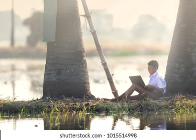 Rural students are learning from their laptop on the backyard. Technology is vital to education, even in areas far away from technological advancement, the Internet can reach people without borders.