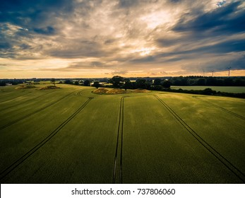Rural sunset over farm fields
