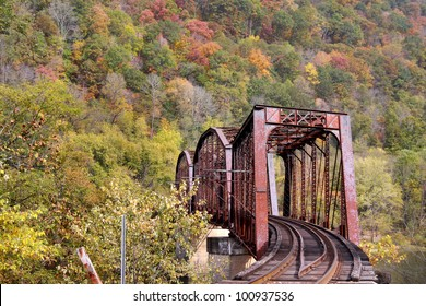 Rural train track in west virginia mountains in autumn time