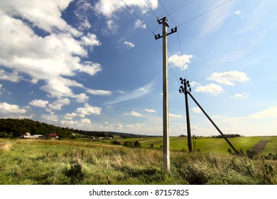 rural view with beautiful sky and electric poles