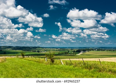 Rural view of a green field in Illinois country side on a sunny day