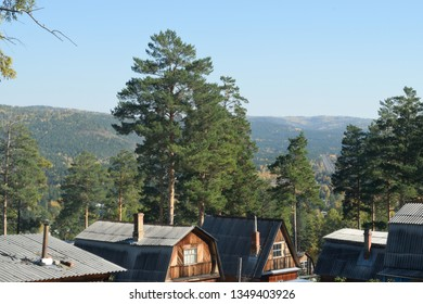 Rural View of Russian Dachas or Holiday Homes in Siberia with a Railway Visible in the Background