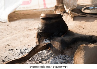 Rural Vintage Kitchen using firewood in-earthen chulhas for cooking food.