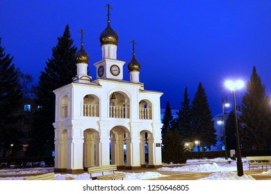 Rural white orthodox church with bell tower