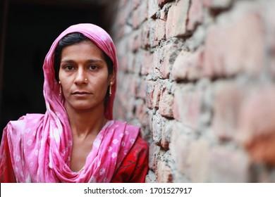 Rural women portrait near brick wall.