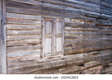 Rural wood wall and window. Old house in village