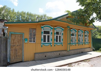 Rural wooden house with carved windows in Suzdal city (Russia)