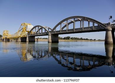 Rural yellow, raising cantilever bridge, Sacramento River, California, USA