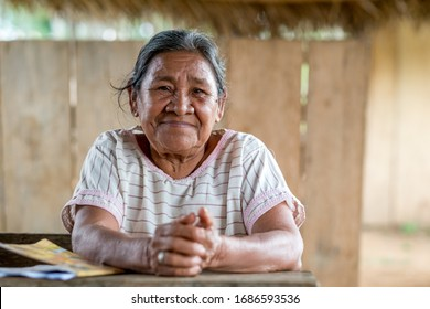 Rurrenabaque, Beni / Bolivia - May 13 2016: Old Wise Looking Indigenous Woman in White Dress Smiles at the Camera