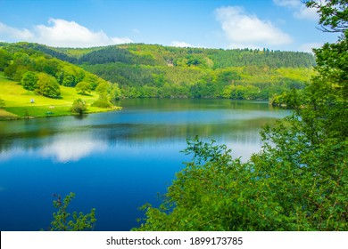 Rursee at Eifel National Park, Germany. Scenic view of lake Rursee and surrounded green hills in North Rhine-Westphalia