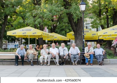 RUSE, BULGARIA - AUGUST 02, 2015: Old friends sitting on the bench.