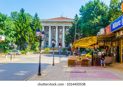RUSE, BULGARIA, AUGUST 11, 2014: People are walking on a street in Ruse, Bulgaria