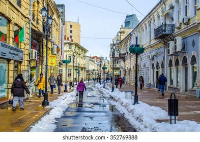 RUSE, BULGARIA, FEBRUARY 22, 2015: people are walking on the street leading to the main square of bulgarian city ruse.
