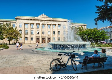 Ruse, Bulgaria - September 10, 2017: View of Justice palace with fountain and walking people, Ruse, Bulgaria