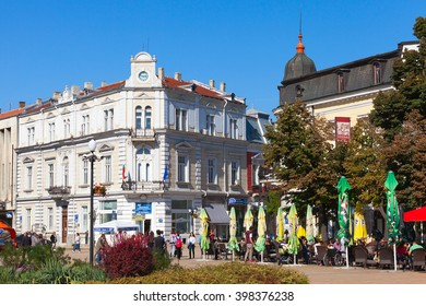 Ruse, Bulgaria - September 29, 2014: Street view with ordinary citizens walking on city square near Aleksandrovska street