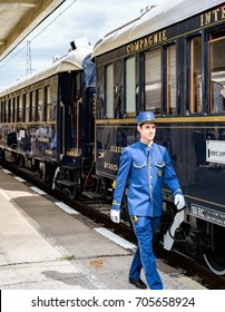 Ruse city, Bulgaria - August 29, 2017. The butler. The legendary Venice Simplon Orient Express is ready to depart from Ruse Railway station. The luxury train travels between Paris and Istanbul.