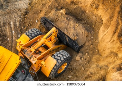 Ruse city, Bulgaria - September 18, 2017, The modern excavator performs excavation work on the construction site in Ruse city, Bulgaria.
