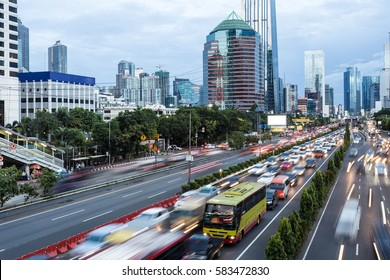 Rush hour along Gatot Subroto highway in the heart of Jakarta business district in Indonesia capital city at twilight. Jakarta is Southeast Asia largest city.