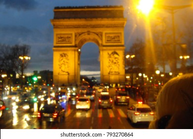 Rush hour with blurred of traffic jam on avenue des Champs-Elysees and the Arc de Triomphe monument national at night in Paris, France
