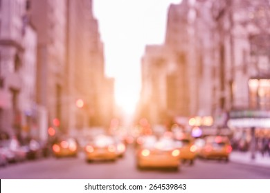 Rush hour with defocused yellow taxi cabs and traffic jam on 5th avenue in Manhattan downtown at sunset - Blurred bokeh postcard of New York City on a vintage marsala color filtered look