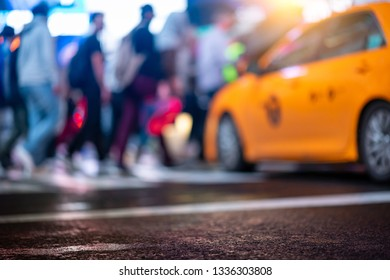 Rush hour in New York City. A defocused colorful abstract background with typical yellow cab and pedestrians crossing the street.