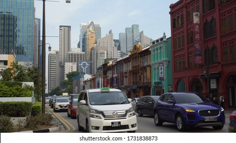 Rush Hour Traffic in Chinatown District With Modern City Skyline in Background in Singapore - August, 2019