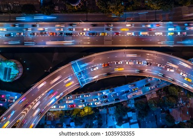 Rush hour traffic on a city roads. Modern metropolis with intersection of the traffic trails on a highway. Traffic jams of roadside, transportation motion in a big city.